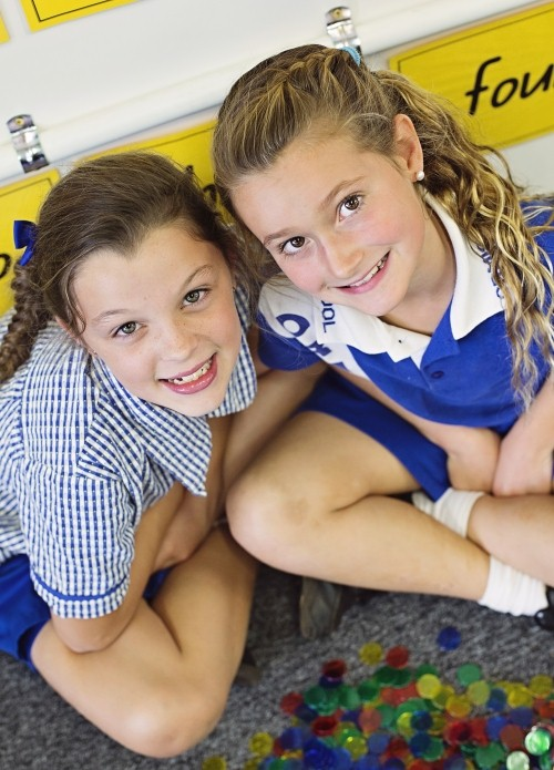 Two students sitting on floor